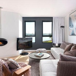 Salon de luxe avec cheminée suspendue : Photos et idées déco ...