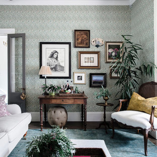 Traditional enclosed living room in Sydney with green walls and dark hardwood floors.