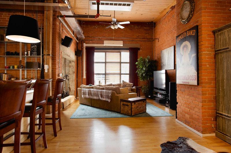 Industrial Living Room by AMR Design