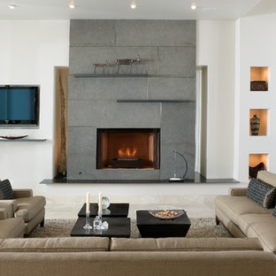 This is an example of a medium sized modern formal enclosed living room in Sacramento with white walls, travertine flooring, a standard fireplace, a concrete fireplace surround, a built-in media unit and beige floors.