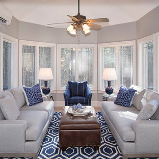 Inspiration for a mid-sized transitional porcelain tile and gray floor living room remodel in Boston with gray walls and no fireplace