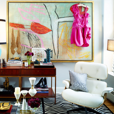 Inspiration for an eclectic living room remodel in New York with blue walls