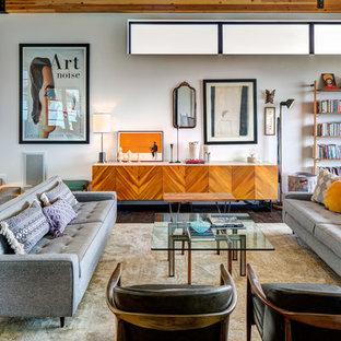 This is an example of a retro open plan living room in Salt Lake City with a reading nook, grey walls and dark hardwood flooring.