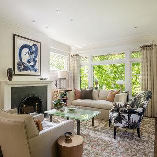 Ispirazione per un soggiorno american style aperto e di medie dimensioni con cornice del camino in metallo, sala formale, pareti beige, parquet scuro, camino classico e nessuna TV
