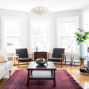 Living room - scandinavian light wood floor and beige floor living room idea in Boston with white walls and a wood stove