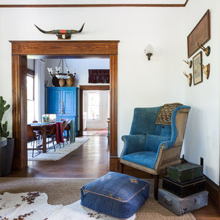 Mid-sized southwest formal and enclosed medium tone wood floor and brown floor living room photo in Houston