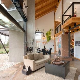 Eclectic concrete floor living room photo in Seattle