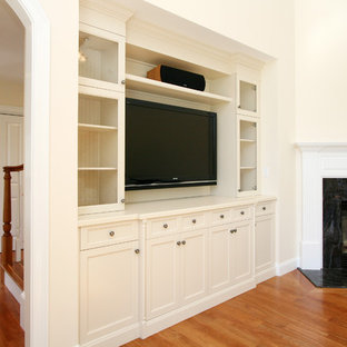 Inspiration for a mid-sized traditional open concept living room in Boston with medium hardwood floors, a corner fireplace, a stone fireplace surround, a built-in media wall, a home bar and beige walls.