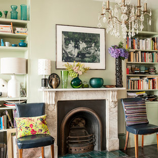 Design ideas for a medium sized eclectic formal enclosed living room in Sussex with green walls, painted wood flooring, a stone fireplace surround and a standard fireplace.