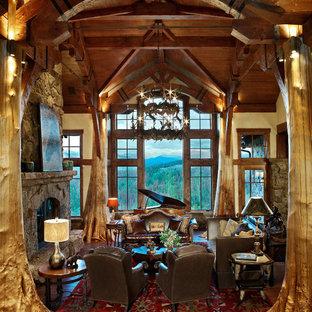 Imagen de salón rural con marco de chimenea de piedra
