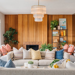 Photo of a retro formal living room in San Diego with white walls, a standard fireplace, a tiled fireplace surround and no tv.