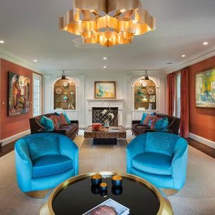 フィラデルフィアの大きいトランジショナルスタイルのおしゃれな独立型リビング (フォーマル、オレンジの壁、カーペット敷き、標準型暖炉、石材の暖炉まわり、テレビなし) の写真