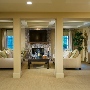 Example of a classic living room design in Philadelphia with a standard fireplace, a stone fireplace and a wall-mounted tv