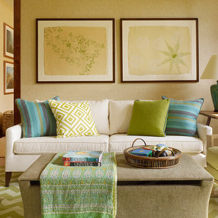 Design ideas for a mid-sized tropical enclosed living room in Hawaii with beige walls and medium hardwood floors.