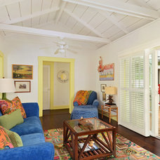 Tropical Living Room by Peabody's Interiors