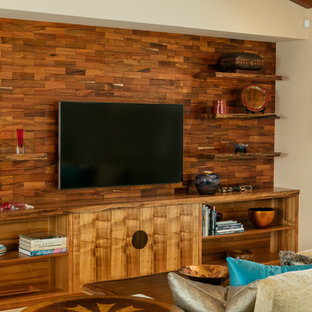 Inspiration for a tropical enclosed living room in Hawaii with beige walls, no fireplace and a wall-mounted tv.