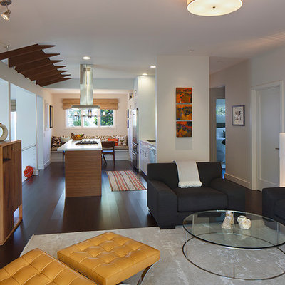 Inspiration for a contemporary open concept dark wood floor living room remodel in San Francisco with white walls