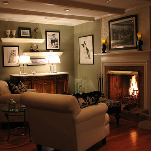 Small traditional formal enclosed living room in Other with green walls, dark hardwood floors, a standard fireplace, a brick fireplace surround and no tv.
