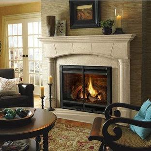 Ispirazione per un soggiorno classico aperto con pareti beige, camino classico e cornice del camino in cemento