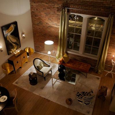Large urban medium tone wood floor living room photo in Raleigh