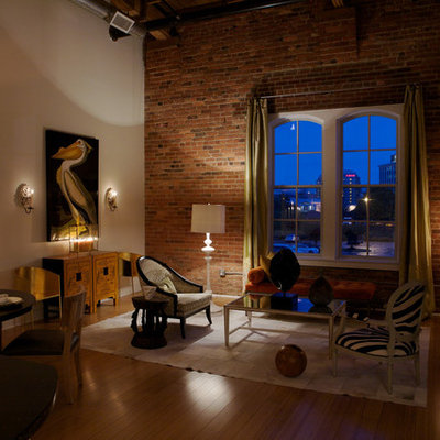 Inspiration for a large industrial medium tone wood floor living room remodel in Raleigh