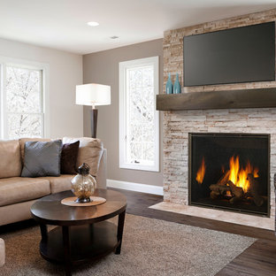 Inspiration for a large contemporary open plan living room in Boston with brown walls, dark hardwood flooring, a standard fireplace, a stone fireplace surround, a wall mounted tv and brown floors.