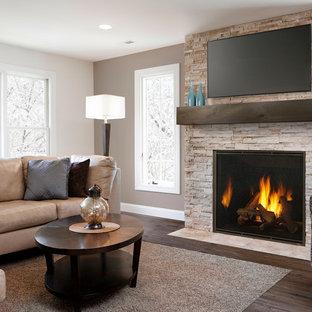 ボストンの大きいコンテンポラリースタイルのおしゃれなLDK (茶色い壁、濃色無垢フローリング、標準型暖炉、石材の暖炉まわり、壁掛け型テレビ、茶色い床) の写真