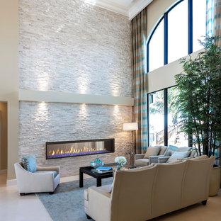 Réalisation d'un salon minimaliste de taille moyenne et ouvert avec un mur beige, un sol en bois clair, une cheminée ribbon, un manteau de cheminée en pierre, un sol beige, une salle de réception et aucun téléviseur.