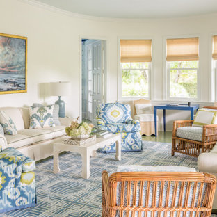 Example of a beach style formal and enclosed painted wood floor and green floor living room design in Portland Maine with white walls and no tv