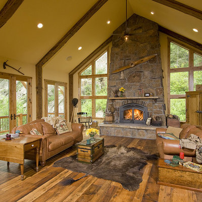 Living room - mid-sized rustic formal and open concept dark wood floor living room idea in Denver with a stone fireplace, beige walls, a standard fireplace and no tv