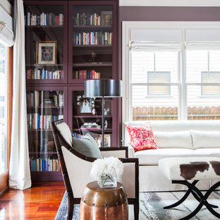 Example of a transitional living room library design in Houston with purple walls