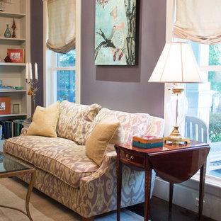 Immagine di un soggiorno classico di medie dimensioni e chiuso con sala formale, pareti viola, pavimento in cemento, cornice del camino in pietra e camino classico