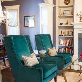 Ispirazione per un soggiorno chic di medie dimensioni e chiuso con sala formale, pareti viola, pavimento in cemento, cornice del camino in pietra e camino classico