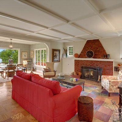 Cottage living room photo in Seattle with beige walls, a standard fireplace and a brick fireplace