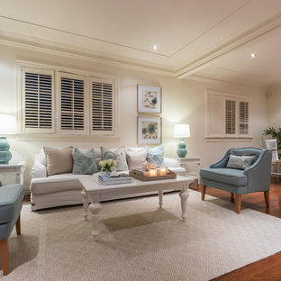Design ideas for a beach style formal open concept living room in Brisbane with beige walls, medium hardwood floors and brown floor.