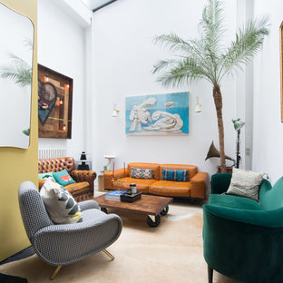 Eclectic enclosed living room in London with white walls and beige floors.