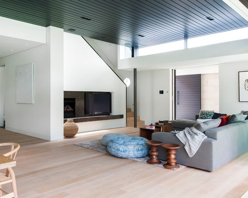 Inspiration For A Large Contemporary Open Concept Medium Tone Wood Floor Living Room Remodel In Sydney