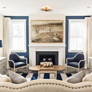 ボストンの大きいビーチスタイルのおしゃれな独立型リビング (フォーマル、マルチカラーの壁、濃色無垢フローリング、標準型暖炉、金属の暖炉まわり、テレビなし、茶色い床) の写真
