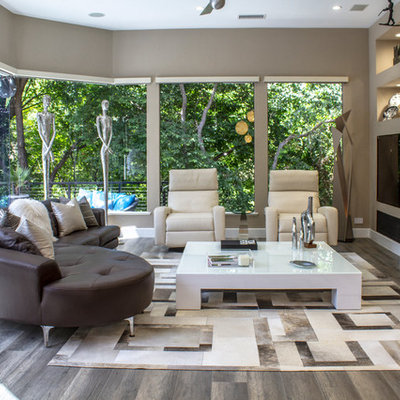Living room - large contemporary formal and open concept dark wood floor living room idea in Dallas with gray walls, no fireplace and a wall-mounted tv
