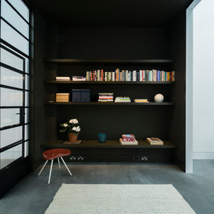 Design ideas for an expansive industrial formal open concept living room in London with black walls and concrete floors.