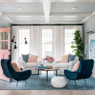 Inspiration for a transitional light wood floor living room remodel in Other with blue walls