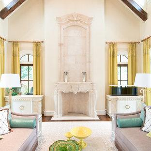 サンディエゴの小さいシャビーシック調のおしゃれなLDK (フォーマル、白い壁、濃色無垢フローリング、横長型暖炉、石材の暖炉まわり、内蔵型テレビ) の写真