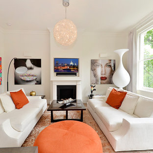 Photo of a scandinavian formal living room in London with white walls, light hardwood flooring, a standard fireplace, a stone fireplace surround and a wall mounted tv.