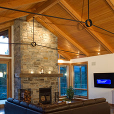 Traditional Living Room by Kettle River Timberworks Ltd.