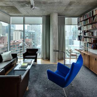 Imagen de biblioteca en casa urbana con paredes grises