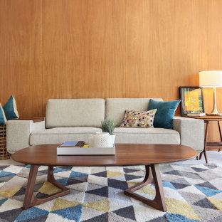 Foto de salón para visitas abierto, vintage, de tamaño medio, sin televisor, con paredes marrones, moqueta y suelo gris