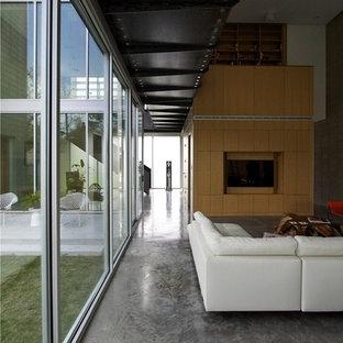 Idéer för ett modernt vardagsrum, med betonggolv och grått golv