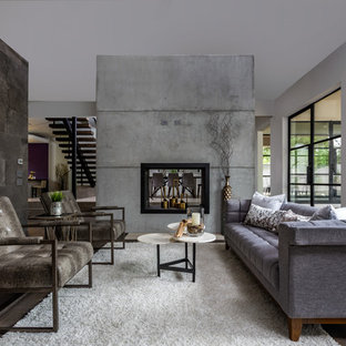 Contemporary living room in Houston with brown walls, dark hardwood flooring, a two-sided fireplace and brown floors.