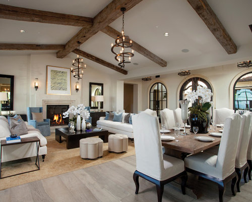Mediterranean Formal And Open Concept Living Room Idea In Orange County With A Standard Fireplace