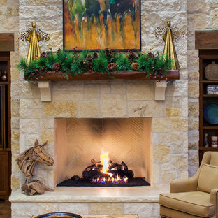 Living room - farmhouse living room idea in Austin with a standard fireplace and a stone fireplace